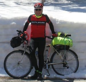 Geoff Jones with bike and snow drift